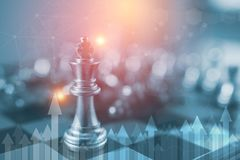 stock image of  investment leadership concept : the king chess piece with chess others nearby go down from floating board game concept of business