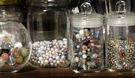 stock image of  jar of beads for creating art hobbies jewelry