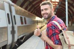 stock image of  joyful public transportation passenger giving a thumbs up