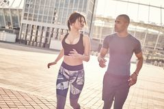 stock image of  keeping fit. cute young interracial couple are doing morning workout and jogging together. common hobbies