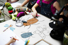 stock image of  kid drawing placard felt pen table