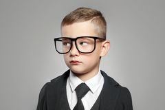 stock image of  kid in formal suit and glasses