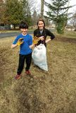 stock image of  kids collecting trash - community clean up