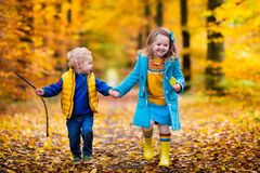 stock image of  kids playing in autumn park