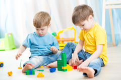 stock image of  kids playing with constructor