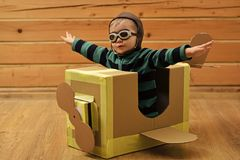 stock image of  kids playing with toys. pilot travel, airdrome, imagination.