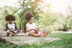 stock image of  kids reading with friend.