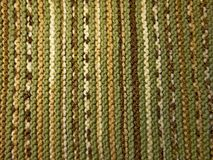 stock image of  knitted fabric texture. background image. hobbies, leisure, crafts. green and brown