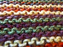 stock image of  knitting. knitted multicolored fabric. knitting texture. close-up. background image. hobbies, leisure, crafts