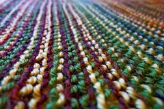 stock image of  knitting. knitted multicolored fabric. knitting texture. background image. hobbies leisure crafts