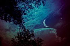 stock image of  landscape of sky with crescent moon and star at night. serenity
