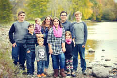stock image of  large family by river
