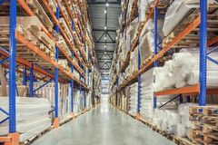 stock image of  large logistics hangar warehouse with lots shelves or racks with pallets of goods. industrial shipping and cargo delivery