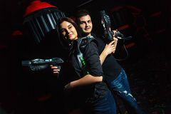 stock image of  laser tag girl and guy
