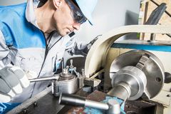 stock image of  lathe technician at work