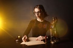 stock image of  lawyer business women working and notary signs the documents at office. consultant lawyer, justice and law ,attorney