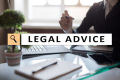 stock image of  legal advice ext on virtual screen. consulting. attorney at law. lawyer, business and finance concept.
