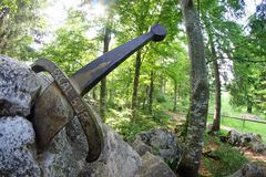 stock image of  legendary sword excalibur to king stuck between the r
