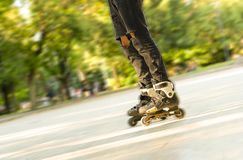 stock image of  legs rolling around on roller skates. entertainment and leisure. sports and hobbies of teenagers