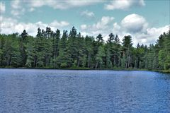 stock image of  leonard pond located in childwold, new york, united states