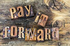 stock image of  pay it forward message letterpress
