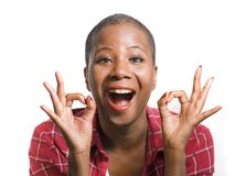 stock image of  lifestyle isolated portrait of young attractive and natural black afro american woman gesturing happy celebrating success in okay