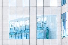 stock image of  light blue reflections of buildings