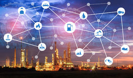 stock image of  light oil refinery at twilight with physical system icons diagram on industrial factory. industry on technology 4.0 concept