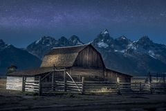 stock image of  light paint on thomas molton barn, part of the mormon row on grand teton national park. also with milky way behind it.