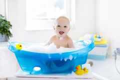 stock image of  little baby taking a bath