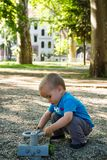 stock image of  little boy playing in nature