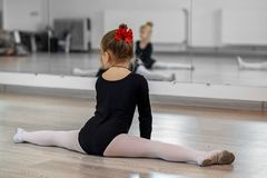 stock image of  little girl doing splits. the concept of sport, education, hobbies, training