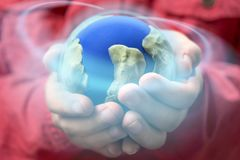 stock image of  little girl holding earth globe with glowing circle. on global and enviroment concept