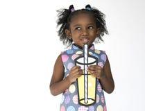 stock image of  little girl holding papercraft arts drinks studio portrait