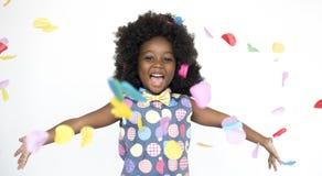 stock image of  little girl listening music headphones studio portrait