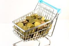 stock image of  little shopping cart full money