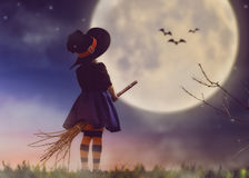 stock image of  little witch outdoors
