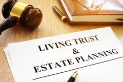 stock image of  living trust and estate planning form on desk.