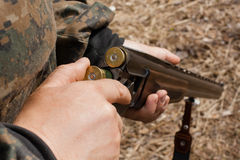 stock image of  loading gun