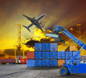 stock image of  logistic business working in container shipping yard with dusky sky and jet plane cargo flying above use for land to air transport