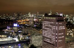 stock image of  london night scene, canary wharf office buildings
