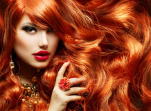 stock image of  long curly red hair