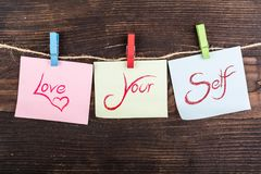 stock image of  love your self note