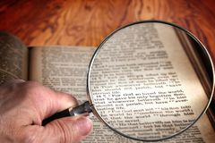 stock image of  magnifying glass on famous bible verse john 3:16