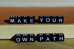 stock image of  make your own path on wooden blocks. motivation and inspiration concept