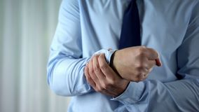 stock image of  male manager feeling wrist pain, joint inflammation, carpal tunnel syndrome