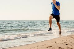 stock image of  male runner running