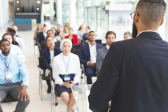 stock image of  male speaker speaks in a business seminar