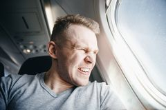 stock image of  man is angry in plane before departure. concept aircraft delay