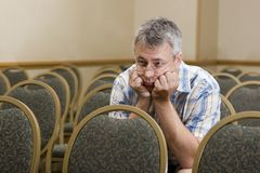stock image of  man at a boring conference